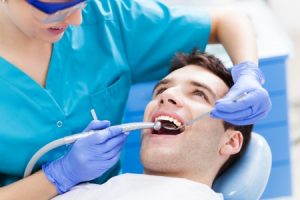 man having teeth examined at dentist