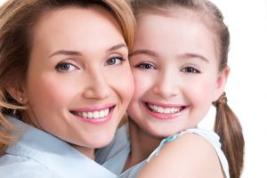 happy mom and daughter with beautiful smiles